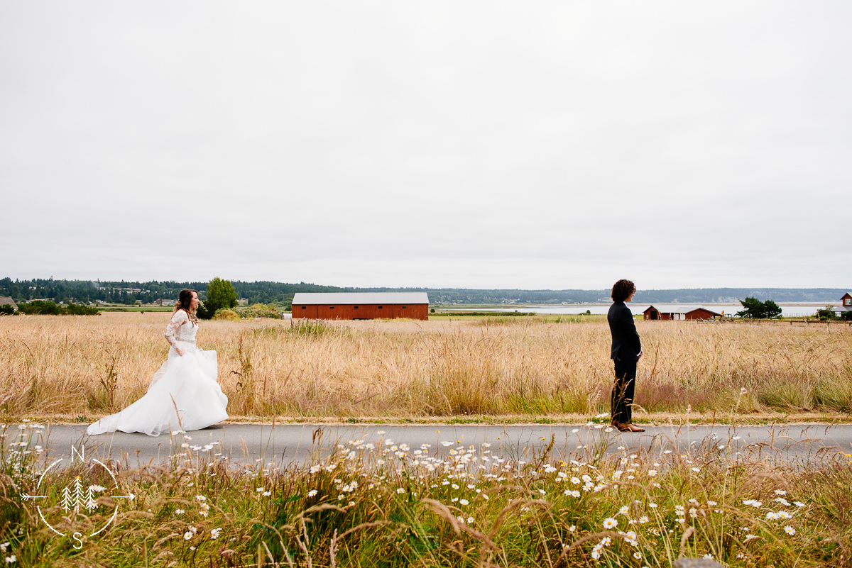 Bride and groom's first look on open field at Crockett Farm on Whidbey Island.