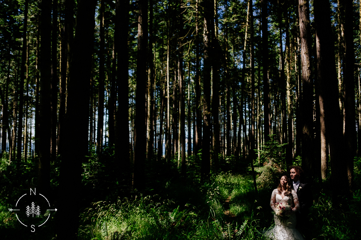 Bridal portraits of bride and groom in the forest at Fort Casey State Park on Whidbey Island.