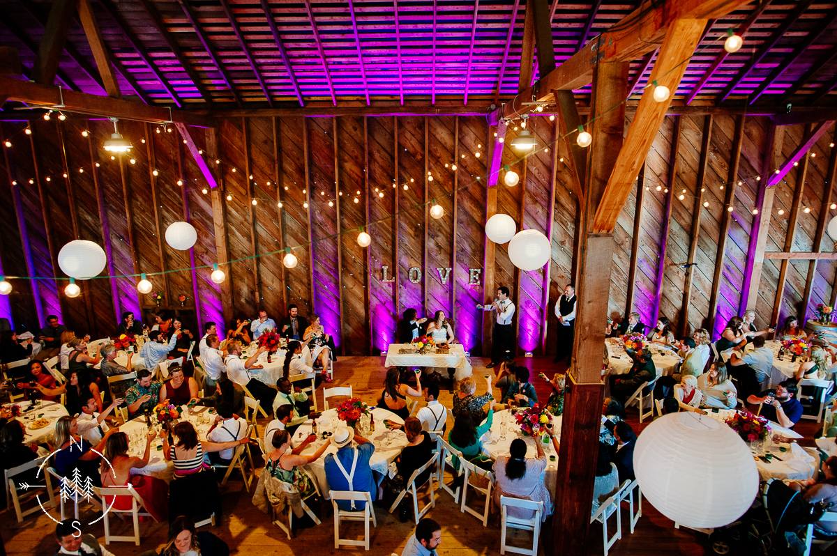 View from above of a barn wedding reception at Crockett Farm venue of Whidbey Island Weddings.