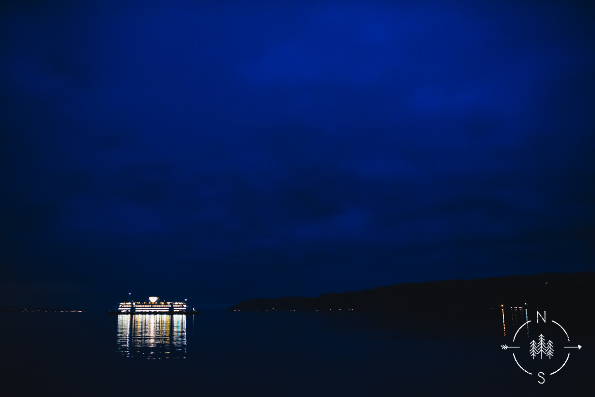 The Whidbey Island ferry on Puget Sound at night as the light reflects off the water